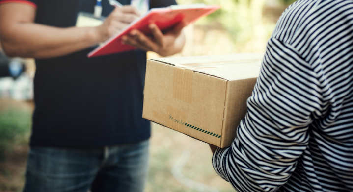 Close up woman holding box with Service delivery and holding a b
